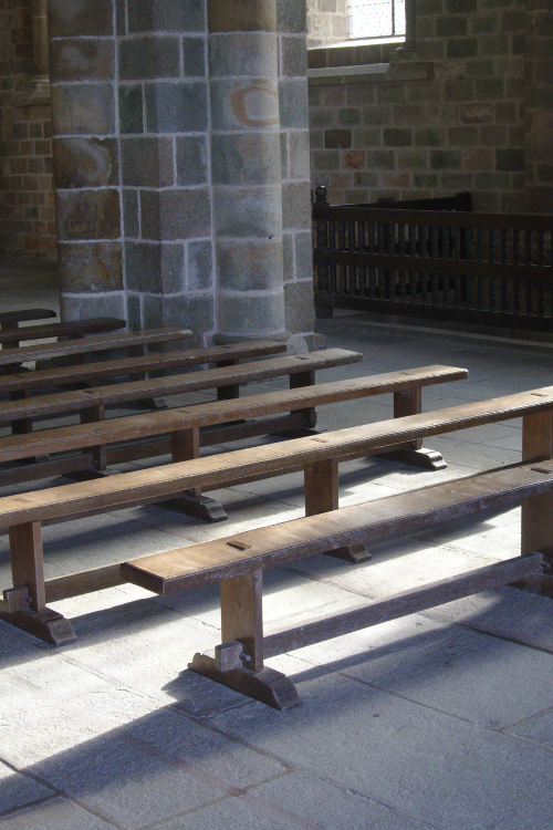 Photo of benches inside of stone church