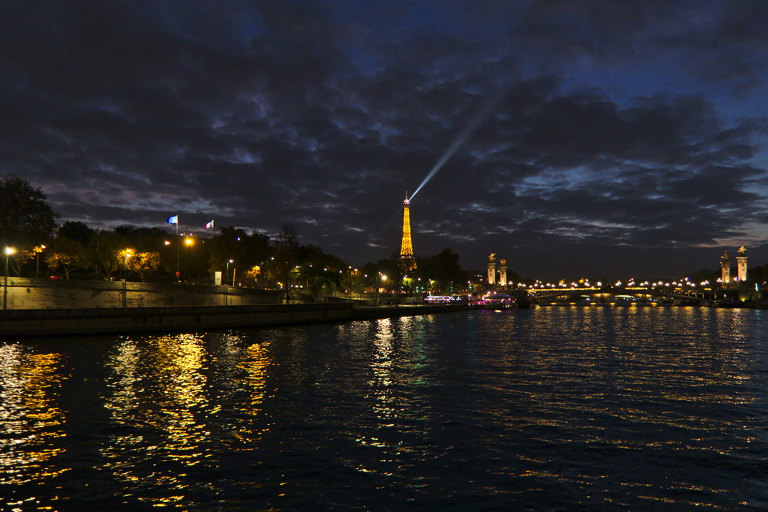 Eiffel Tower from the river at night