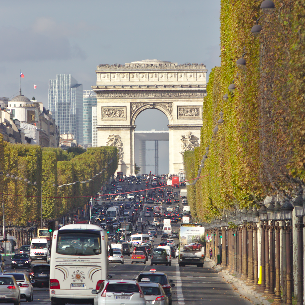 Photo of Arc de Triomphe and traffic on Champs Elysees